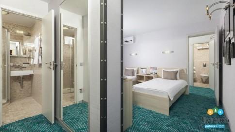 Люкс 4-местный 2-комнатный с одной двуспальной кроватью и двумя раскладными креслами Грин Парк, фото 1